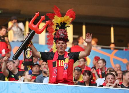 NICE, FRANCE - JUNE 22, 2016: Belgian fan shows his support during the UEFA EURO 2016 game Sweden v Belgium at Allianz Riviera Stade de Nice, Nice, France. Belgium won 1-0