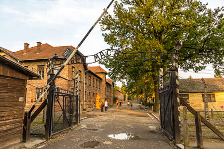 AUSCHWITZ, POLAND - AUGUST 27, 2017. Arbeit macht frei sign on the main entrance gateway to Auschwitz-Birkenau (Auschwitz I) concentration camp near Oswiecim city, Poland