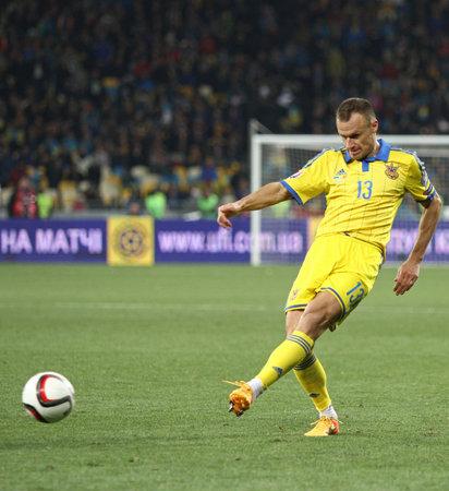 KYIV, UKRAINE - OCTOBER 12, 2015: Vyacheslav Shevchuk of Ukraine kicks a ball during the UEFA EURO 2016 Qualifying game against Spain at NSK Olimpiyskyi stadium in Kyiv