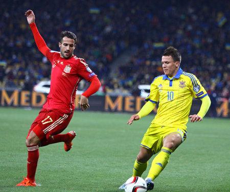 KYIV, UKRAINE - OCTOBER 12, 2015: Yevhen Konoplyanka of Ukraine (R) fights for a ball with Mario Gaspar of Spain during their UEFA EURO 2016 Qualifying game at NSK Olimpiyskyi stadium. Spain won 1-0