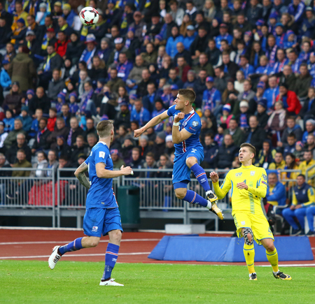 REYKJAVIK, ICELAND - SEPTEMBER 5, 2017: Johann Gudmundsson of Iceland (C) kicks a ball during the FIFA World Cup 2018 qualifying game against Ukraine at Laugardalsvollur stadium in Reykjavik, Iceland Editorial