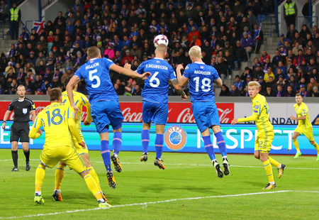 REYKJAVIK, ICELAND - SEPTEMBER 5, 2017: Icelandic players (in Blue) fight for a ball with Ukrainian players during their FIFA World Cup 2018 qualifying game at Laugardalsvollur stadium.Iceland won 2-0 Editorial