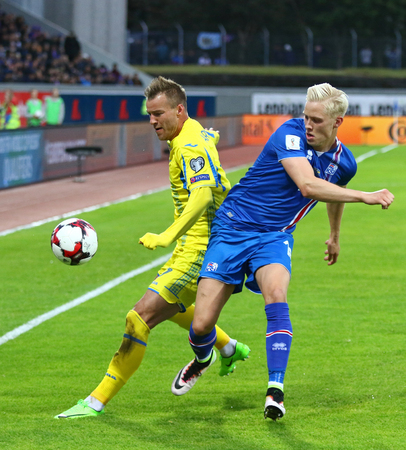 REYKJAVIK, ICELAND - SEPTEMBER 5, 2017: Hordur Magnusson of Iceland (R) fights for a ball with Andriy Yarmolenko of Ukraine during their FIFA World Cup 2018 qualifying game in Reykjavik, Iceland