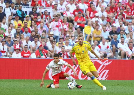 MARSEILLE, FRANCE - JUNE 21, 2016: Andriy Yarmolenko of Ukraine (R) and Bartosz Kapustka of Poland in action during their UEFA EURO 2016 game at Stade Velodrome in Marseille, France. Poland won 1-0 Editöryel