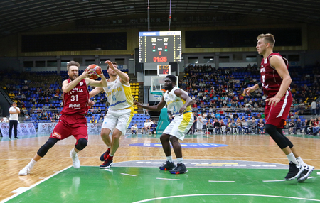 KYIV, UKRAINE - JULY 1, 2018: FIBA World Cup 2019 European Qualifiers game Ukraine (in White) v Latvia (in Red) at Palace of Sports in Kyiv. Latvia won 93-71