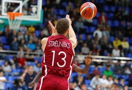 KYIV, UKRAINE - JULY 1, 2018: Janis Strelnieks of Latvia in action during the FIBA World Cup 2019 European Qualifiers game Ukraine v Latvia at Palace of Sports in Kyiv. Latvia won 93-71