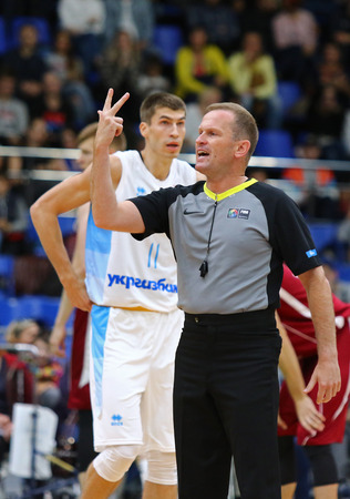 KYIV, UKRAINE - JULY 1, 2018: Basketball referee in action during the FIBA World Cup 2019 European Qualifiers basketball game Ukraine v Latvia at Palace of Sports in Kyiv