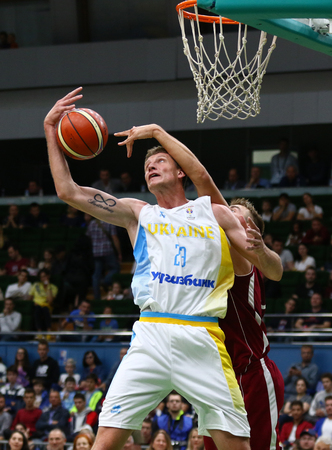 KYIV, UKRAINE - JULY 1, 2018: Artem Pustovyi of Ukraine rebounds a ball during the FIBA World Cup 2019 European Qualifiers game against Latvia at Palace of Sports in Kyiv. Latvia won 93-71