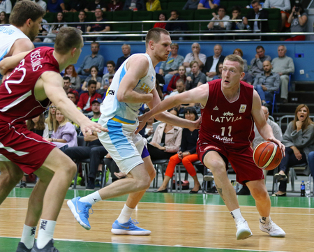 KYIV, UKRAINE - JULY 1, 2018: Rolands Smits of Latvia (R) in action during the FIBA World Cup China 2019 European Qualifiers game Ukraine v Latvia at Palace of Sports in Kyiv. Latvia won 93-71
