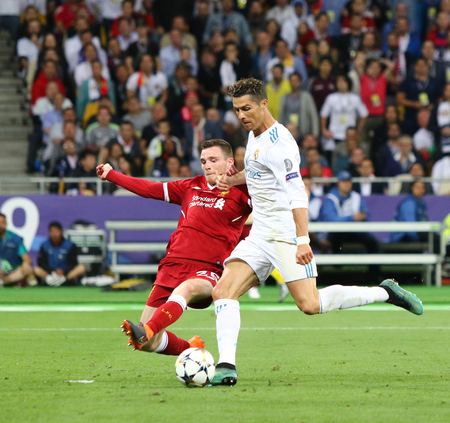 KYIV, UKRAINE - MAY 26, 2018: Andy Robertson of Liverpool (L) fights for a ball with Cristiano Ronaldo of Real Madrid during their UEFA Champions League Final 2018 game in Kyiv. Real Madrid won 3-1