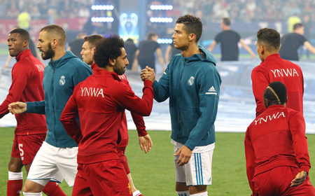 KYIV, UKRAINE - MAY 26, 2018: Mohamed Salah of Liverpool (L) cheers Cristiano Ronaldo of Real Madrid before their UEFA Champions League Final 2018 game at NSC Olimpiyskiy Stadium. Real Madrid won 3-1 Editorial