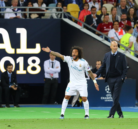 KYIV, UKRAINE - MAY 26, 2018: Players Marcelo and coach Zinedine Zidane of Real Madrid in action during the UEFA Champions League Final 2018 game against Liverpool at NSC Olimpiyskiy Stadium in Kyiv