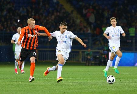 KHARKIV, UKRAINE - MAY 17, 2017: Volodymyr Shepelev of Dynamo Kyiv (R) fights for a ball with Viktor Kovalenko of Shakhtar Donetsk during their Cup of Ukraine Final game at OSC Metalist stadium Editöryel
