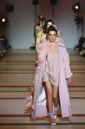 KYIV, UKRAINE - FEBRUARY 3, 2018: Model presents a creation The COAT by designer Katya Silchenko during 42nd Ukrainian Fashion Week season FallWinter 201819 at Mystetskyi Arsenal in Kyiv, Ukraine Editöryel