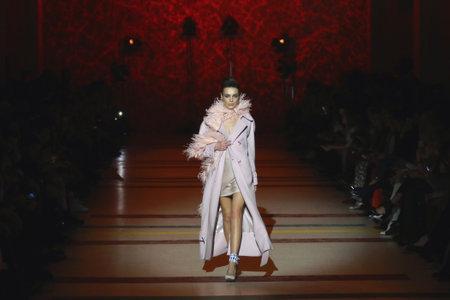 KYIV, UKRAINE - FEBRUARY 3, 2018: Models present a creation The COAT by designer Katya Silchenko during 42nd Ukrainian Fashion Week season FallWinter 201819 at Mystetskyi Arsenal in Kyiv, Ukraine