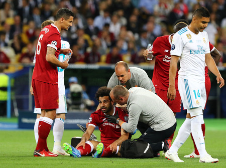 KYIV, UKRAINE - MAY 26, 2018: Mohamed Salah of Liverpool seats on a grass after he had been injured by Sergio Ramos of Real Madrid during their UEFA Champions League Final 2018 game in Kyiv