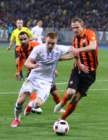 KYIV, UKRAINE - APRIL 21, 2017: Viktor Tsyhankov of Dynamo Kyiv (L) attacks during the Ukrainian Premier League game against Shakhtar Donetsk at NSC Olimpiyskyi stadium in Kyiv, Ukraine