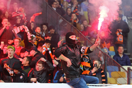 KYIV, UKRAINE - APRIL 21, 2017: Shakhtar Donetsk ultra supporters (ultras) perform during Ukrainian Premier League game against FC Dynamo Kyiv at NSC Olimpiyskyi stadium in Kyiv, Ukraine