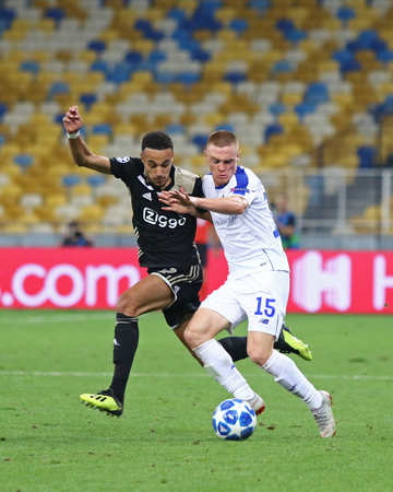 KYIV, UKRAINE - AUGUST 28, 2018: Noussair Mazraoui of AFC Ajax (L) fights for a ball with Viktor Tsygankov of FC Dynamo Kyiv during their the UEFA Champions League play-off game in Kyiv, Ukraine