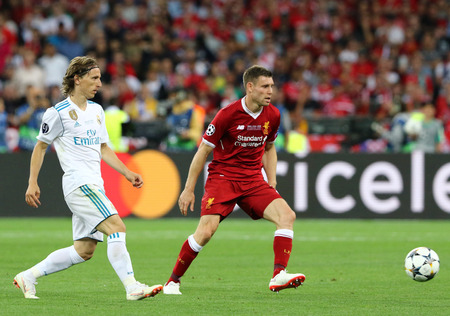 KYIV, UKRAINE - MAY 26, 2018: Luka Modric of Real Madrid (L) fights for a ball with James Milner of Liverpool during their UEFA Champions League Final 2018 game at NSC Olimpiyskiy. Real Madrid won 3-1
