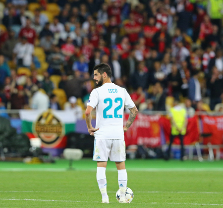 KYIV, UKRAINE - MAY 26, 2018: Isco of Real Madrid kicks-off the ball during the UEFA Champions League Final 2018 game against Liverpool at NSC Olimpiyskiy in Kyiv. Real Madrid won 3-1 Banque d'images - 110869591