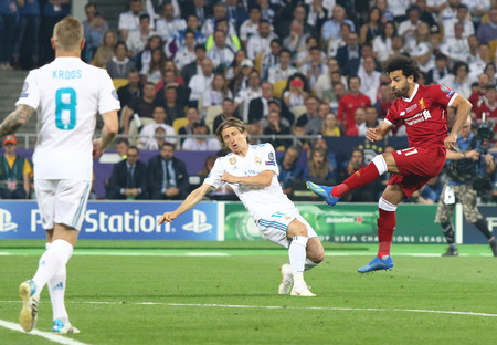 KYIV, UKRAINE - MAY 26, 2018: Mohamed Salah of Liverpool (R) kicks a ball during the UEFA Champions League Final 2018 game against Real Madrid at NSC Olimpiyskiy Stadium. Real Madrid won 3-1 에디토리얼