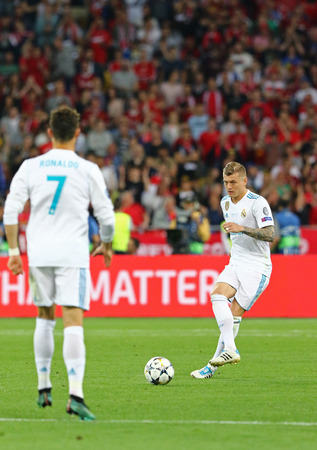 KYIV, UKRAINE - MAY 26, 2018: Toni Kroos of Real Madrid (R) kicks a ball during the UEFA Champions League Final 2018 game against Liverpool at NSC Olimpiyskiy Stadium in Kyiv. Real Madrid won 3-1