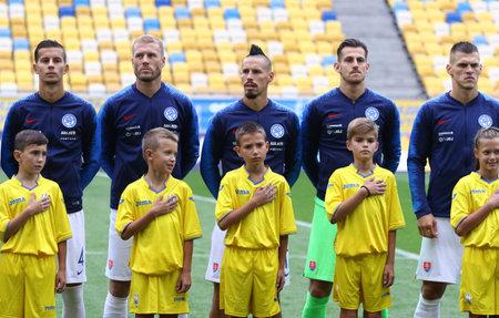 LVIV, UKRAINE - SEPTEMBER 9, 2018: Slovak players listen to the National Anthem before the UEFA Nations League game Ukraine v Slovakia at Arena Lviv stadium in Lviv, Ukraine 写真素材 - 110869820
