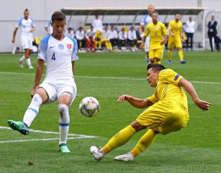 LVIV, UKRAINE - SEPTEMBER 9, 2018: Yevhen Konoplyanka of Ukraine (R) kicks a ball during the UEFA Nations League game against Slovakia at Arena Lviv stadium in Lviv. Ukraine won 1-0