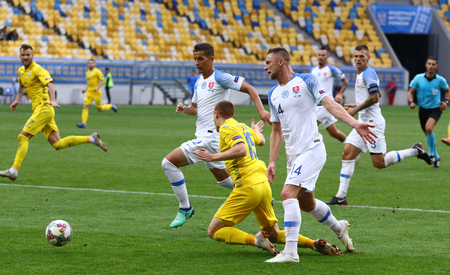LVIV, UKRAINE - SEPTEMBER 9, 2018: Viktor Tsygankov of Ukraine (C) earns a penalty during the UEFA Nations League game against Slovakia at Arena Lviv stadium in Lviv. Ukraine won 1-0
