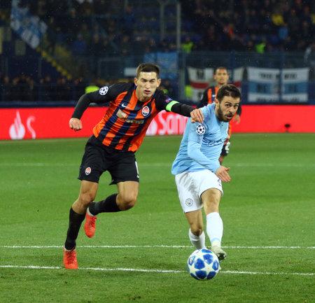 KHARKIV, UKRAINE - OCTOBER 23, 2018: Bernardo Silva of Manchester City (R) scores a 3rd goal during the UEFA Champions League game against Shakhtar Donetsk at OSK Metalist stadium. ManCity won 3-0
