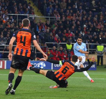 KHARKIV, UKRAINE - OCTOBER 23, 2018: Riyad Mahrez of Manchester City (R) kicks a ball during the UEFA Champions League game against Shakhtar Donetsk at OSK Metalist stadium in Kharkiv. ManCity won 3-0