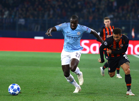 KHARKIV, UKRAINE - OCTOBER 23, 2018: Benjamin Mendy of Manchester City (L) fights for a ball with Maycon of Shakhtar Donetsk during their UEFA Champions League game at OSK Metalist stadium in Kharkiv