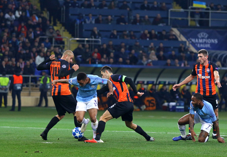 KHARKIV, UKRAINE - OCTOBER 23, 2018: Manchester City (in Blue) and Shakhtar Donetsk players fight for a ball during their UEFA Champions League game at OSK Metalist stadium in Kharkiv. ManCity won 3-0