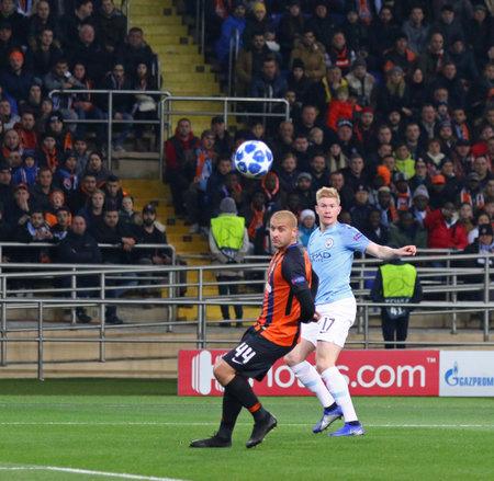 KHARKIV, UKRAINE - OCTOBER 23, 2018: Kevin De Bruyne of Manchester City (R) kicks a ball during the UEFA Champions League game against Shakhtar Donetsk at OSK Metalist stadium. ManCity won 3-0