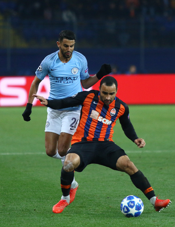 KHARKIV, UKRAINE - OCTOBER 23, 2018: Ismaili of Shakhtar Donetsk (R) fights for a ball with Riyad Mahrez of Manchester City during their UEFA Champions League game at Metalist stadium. ManCity won 3-0
