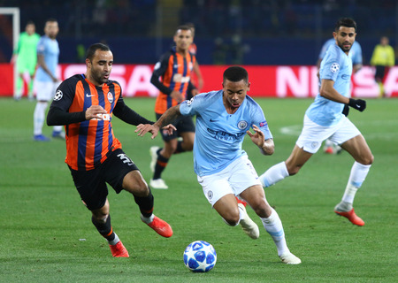KHARKIV, UKRAINE - OCTOBER 23, 2018: Ismaili of Shakhtar Donetsk (L) fights for a ball with Gabriel Jesus of Manchester City during their UEFA Champions League game at OSK Metalist stadium in Kharkiv