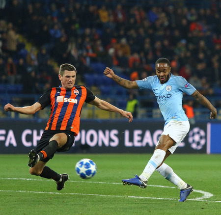 KHARKIV, UKRAINE - OCTOBER 23, 2018: Raheem Sterling of Manchester City (R) kicks a ball during the UEFA Champions League game against Shakhtar Donetsk at OSK Metalist stadium. ManCity won 3-0