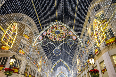 Details of Christmas decorations on Calle Marques de Larios street in the centre of Malaga city, Andalusia, Spain.