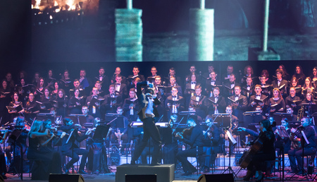 """KYIV, UKRAINE - NOVEMBER 22, 2018: Symphony Orchestra (conductor Andrey Chernyi) and Choir """"Voice of the Sympho Rock"""" perform soundtracks from """"The Game of Thrones"""" on stage of National Palace of Arts"""