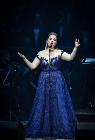 "KYIV, UKRAINE - NOVEMBER 22, 2018: Singer performs on stage during ""The Game of Thrones"" Symphony Orchestra concert at National Palace of Arts ""Ukraina"" in Kyiv"