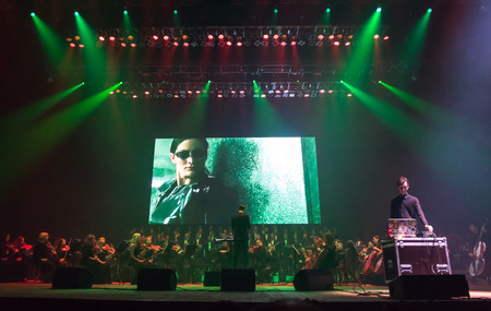 """KYIV, UKRAINE - NOVEMBER 22, 2018: Symphony Orchestra (conductor Andrey Chernyi) and Choir """"Voice of the Sympho Rock"""" perform soundtracks from """"The Game of Thrones"""" on stage of National Palace of Arts Editorial"""
