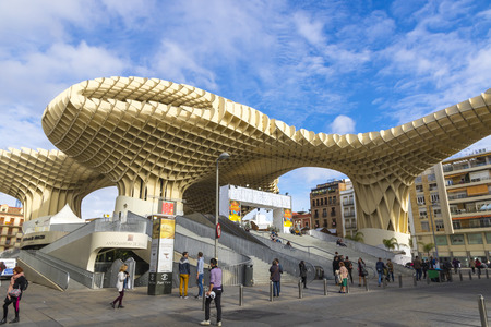 SEVILLE, SPAIN - DECEMBER 15, 2017: The Metropol Parasol (Setas de Sevilla) is a structure in shape of a pergola made of wood and concrete located at La Encarnacion square in Seville old town, Spain Redakční