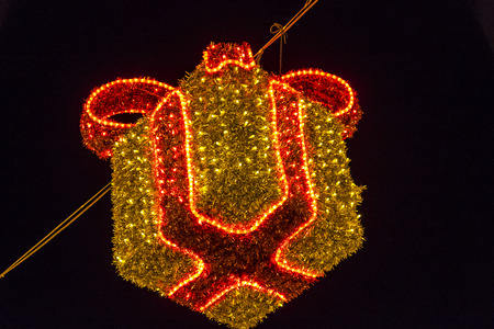 Close-up details of illuminated Christmas holiday decorations over night sky