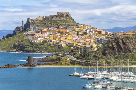 Picturesque view of Medieval town of Castelsardo, province of Sassari, Sardinia, Italy. Popular travel destination. Sea port on the foreground. Mediterranean seacoast