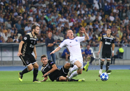 KYIV, UKRAINE - AUGUST 28, 2018: Viktor Tsygankov of FC Dynamo Kyiv (R) fights for a ball with AFC Ajax players during their the UEFA Champions League play-off game at NSC Olimpiyskyi stadium in Kyiv