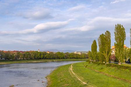 Spring view of Uzh river in Uzhhorod city, Ukraine. Uzh River located in the Transcarpathia region in Ukraine and in Michalovce and Sobrance district in Slovakia. It flows into the Laborec river