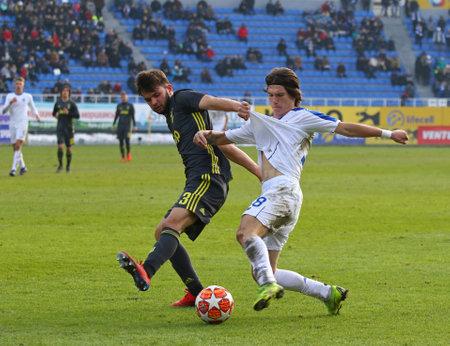 KYIV, UKRAINE - FEBRUARY 20, 2019: Artem Shulianskyi of Dynamo Kyiv U19 (R) fights for a ball with Matteo Anzolin of Juventus U19 during their UEFA Youth League game at Lobanovskiy stadium in Kyiv