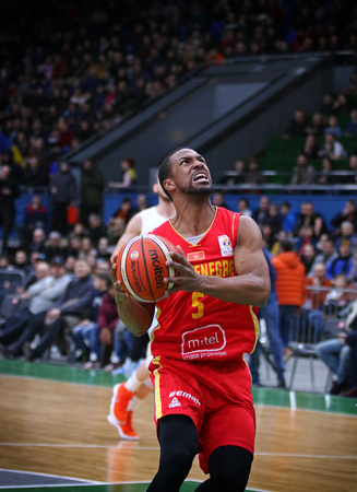 KYIV, UKRAINE - FEBRUARY 22, 2019: Derek Needham of Montenegro in action during the FIBA World Cup 2019 European Qualifiers game Ukraine v Montenegro at Palace of Sports in Kyiv. Montenegro won 76-74 Редакционное