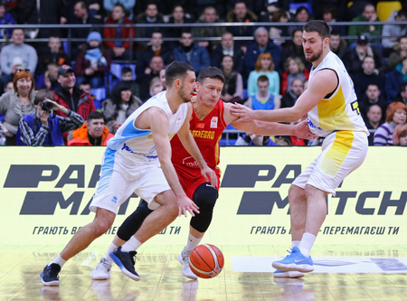 KYIV, UKRAINE - FEBRUARY 22, 2019: FIBA World Cup 2019 European Qualifiers game Ukraine (in White) v Montenegro (in Red) at Palace of Sports in Kyiv. Montenegro won 76-74